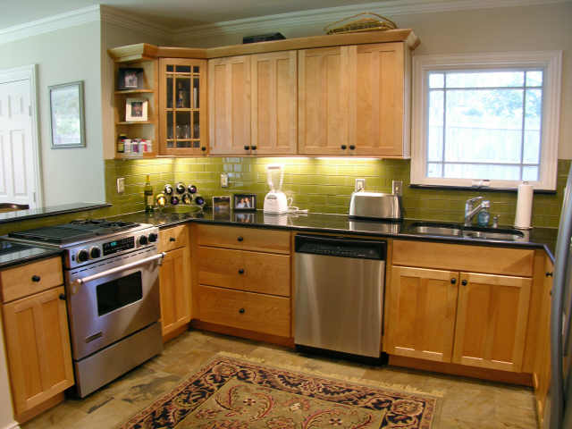 AFTER: A fresh new wall color, Sherwin Williams Happy Camper and warms up  this kitchen and minimizes the intensity of the backsplash! - Glass Subway Tile Backsplash |